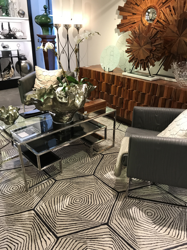 trends wood mirror glass table grey leather chairs graphic area rug